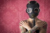 Sexy Woman wearing a Ammo Gas Mask in pink background — Stockfoto
