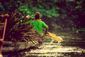 Canoes in the Yasuni national park Ecuador, carring straw plant — Stock Photo