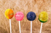Lollipops of vaious colors in an abstract background — 图库照片