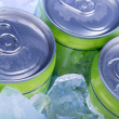 Green Soda can in crushed ice — Stock Photo