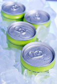 Drink cans with crushed ice — Stock Photo