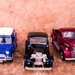 Vintage toy cars in an old background — Stock Photo #42687777