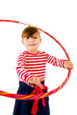 Happy 2 year old girl with hula hoop on white — Stock Photo