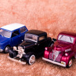 Vintage toy cars in an old background — Stock Photo