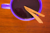 Red soup on a purple bowl — Stok fotoğraf