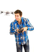 Man playing with a quadcopter drone — Stock Photo