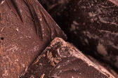 Raw chocolate on chunks — Stock Photo