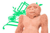 Clay monkey with green lines on a white background — Stock Photo