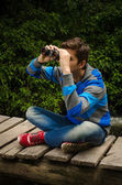 Man with binoculars in the forest — Stock Photo