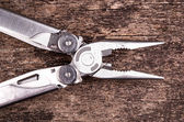 Multitool, multi purpose tool with plyers and knife — Stock Photo