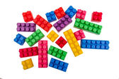 Building blocks scattered on a white background — Foto Stock