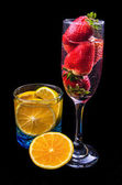 Oranges and strawberries on a glass — Stock Photo