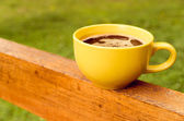 Yellow coffee cup — Stock Photo