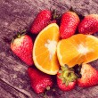 Strawberries and oranges on wood — Stock Photo #45473705