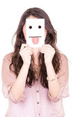 Woman with emoticon on a paper in her face — Stock Photo