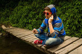 Young man listening to music in the woods — Stok fotoğraf