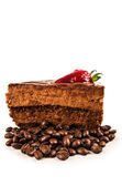Chocolate cake with spilled cofee beans and strawberry on top — Stock Photo