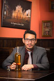 Man in suit with bottle and alcohol shot — Stock Photo