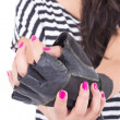 Hands of a girl in striped t-shirt wearing one black glove — Stock Photo #48860891