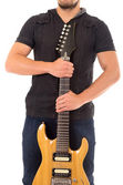 Young guy holding electric guitar — Foto Stock
