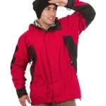 ung man bär röd vinterkappa poserar tittar på något — Stockfoto #49407095