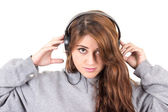 Attractive young red haired girl wearing headphones — Foto de Stock