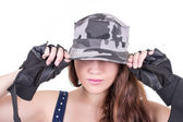 Closeup young girl wearing military cap — Stock Photo