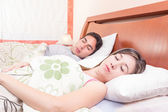 Latin couple lying in bed sleeping — Zdjęcie stockowe