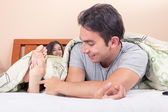 Cute couple lying in bed sleeping — Stock Photo