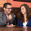 Happy couple sharing strawberry dessert in restaurant — Stock Photo #50040197