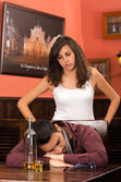 Drunk young man and angry girlfirend in a bar — Stockfoto
