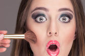 Beautiful young woman getting makeup done — ストック写真