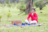 Young man sitting having a picnic — Stock Photo
