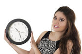 Beautiful young woman holding big round clock time concept — Stok fotoğraf