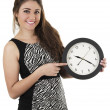 Beautiful young woman holding big round clock — Stock Photo #50595599