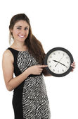 Beautiful young woman holding big round clock — Stok fotoğraf