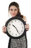 Pretty young hispanic girl holding black round clock — Stok fotoğraf