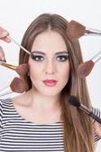 Closeup of beautiful blond girl getting makeup done — Stock Photo