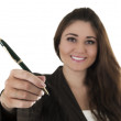 Beautiful young woman holding a pen — Stock Photo #50771097
