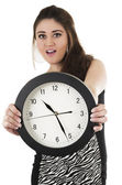 Pretty young hispanic girl holding black round clock — Foto de Stock