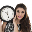 Beautiful young woman holding big round clock — Stock fotografie #50839233