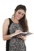 Schöne junge casual mädchen halten, haltungs-notebook年轻漂亮的休闲女孩抱着笔记本摆姿势 — Stockfoto
