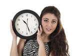 Beautiful young woman holding big round clock — Foto de Stock