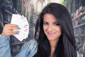 Pretty young brunette woman posing with deck of cards — Foto Stock