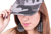 Face closeup of young girl holding military cap with hand — Stock Photo