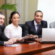Multi ethnic business team at a meeting — Stock Photo #20506071