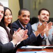 Foto Stock: Multi ethnic business group greets you with clapping