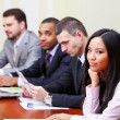 Multi ethnic business executives working with documents — Stock Photo