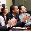 Stock Photo: Multi ethnic business group greets somebody