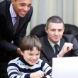 Stock Photo: Kid boy explains multi ethnic business team how to work